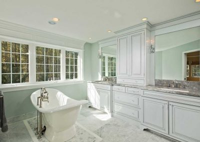 "The master bathroom has a 72"" free-standing cast-iron soaking tub, and two spacious vanities."