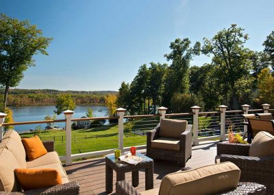The deck is complete with cable railings to not obstruct the view of the lake.