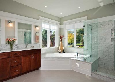 The master bathroom was finished with granite countertops, custom cabinetry and large ceramic tile flooring.