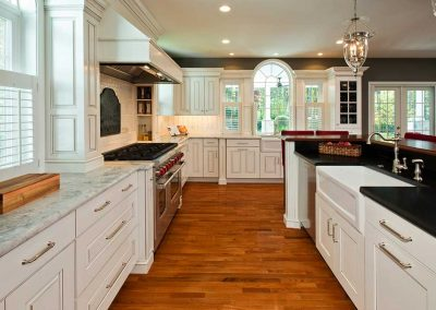 A handcrafted kitchen is spacious enough to host any number of friends and family. Finished with two farm style ceramic sinks and a butler's pantry.